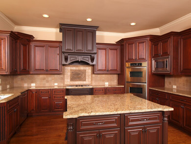 Custom Cherry Kitchen With Big Island And Dark Stained Range Hood. Granite  Countertops With Tile