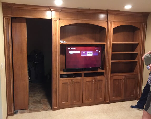Entertainment center with hidden bookcase door.