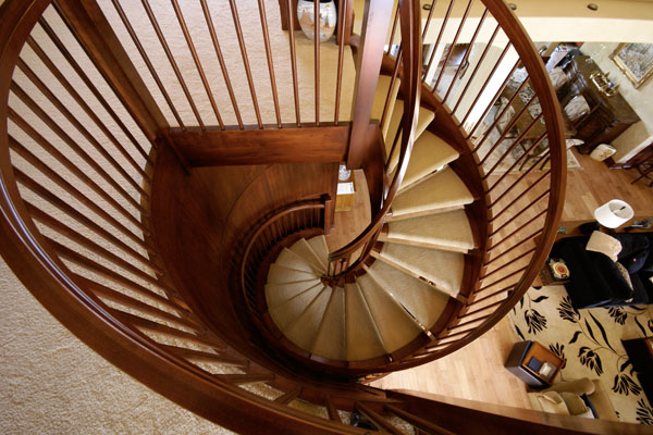Amazing spiral staircases carpenter wichita, ks. Cherry stairs with solid cherry stair treads and a carpet runner looking down.