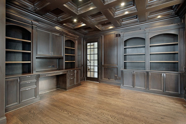 Beautiful cabinetry wichita tray ceilings in study.