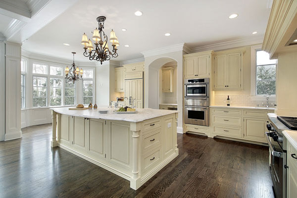 Beautiful custom kitchen island with enamel finish and stone counters.