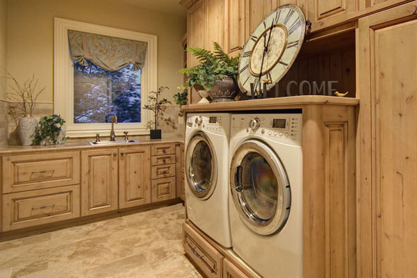 Beautiful custom built laundry room cabinets with built in washer and dryer.