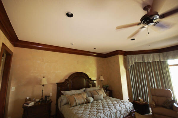 Bedroom crown moulding at ceiling. Cherry base and cove moulding in Wichita, Ks.