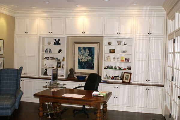 Breath taking home offices with custom built cabinetry finished in white enamel with wood countertop.