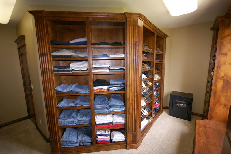 Knotty alder closet shelving with angled shoe racks, fluted columns and adjustable shelving.