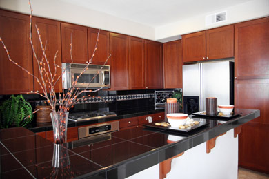 Refaced maple cabinets with shaker style doors, granite tile countertops and stainless steel appliances