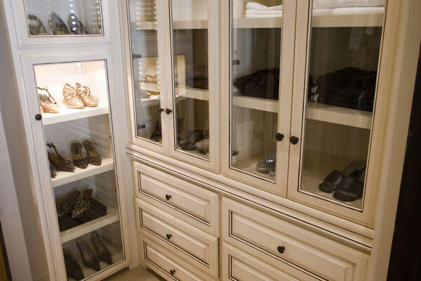 Closet Shelving Cabinetry With Glass Doors Over Shoe Racks, A Built In  Dresser And Sweater