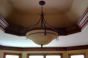 Custom base and crown moulding around ceiling soffit and room perimeter in Wichita, Ks.