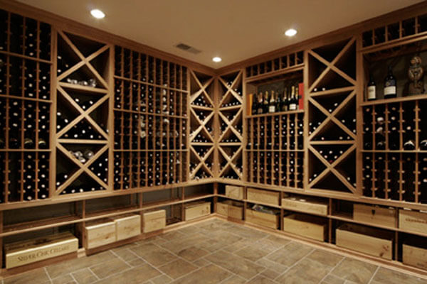 Custom built wine cellars with criss cross storage, individual bottle storage and bulk wine sorage in real wood.