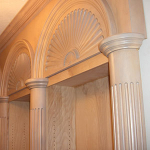 Fancy fluted columns in maple with custom bookcases.