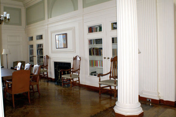 Large home architectural columns with bookshelves