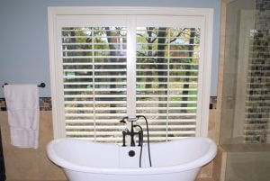 Plantation shutters with custom made maple frames and slipper tub