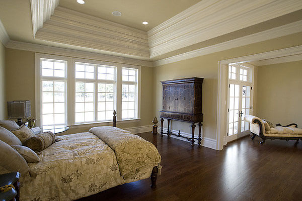 Multi step crown moulding in ceiling coffer with crown moulding around room.