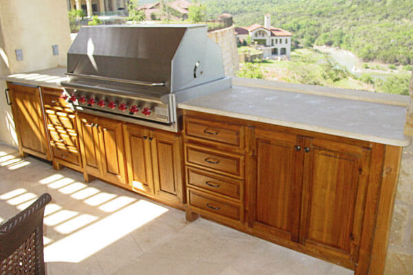 Luxury grill cabinet in teak lumber with stone countertops.