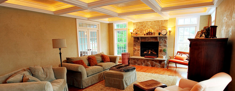 Back lit coffered ceiling with stone fireplace surround and custom mantle. Best trim carpenters in Wichita KS.