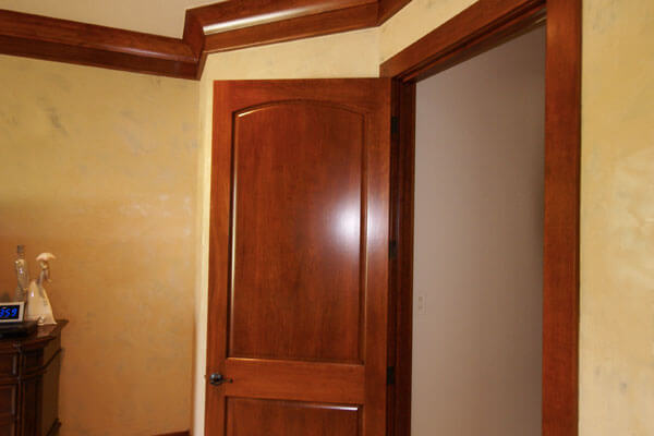 Trim work crown moulding with solid cherry door and casings.