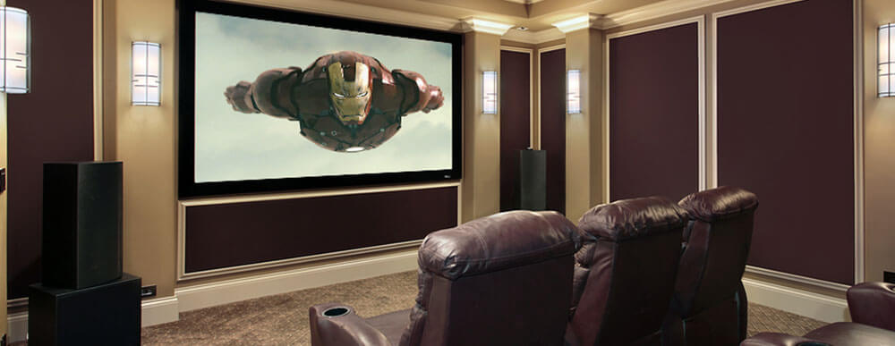 Ultimate home theaters like this feature ornate moldings, beautiful light sconces and ample luxurious seating.