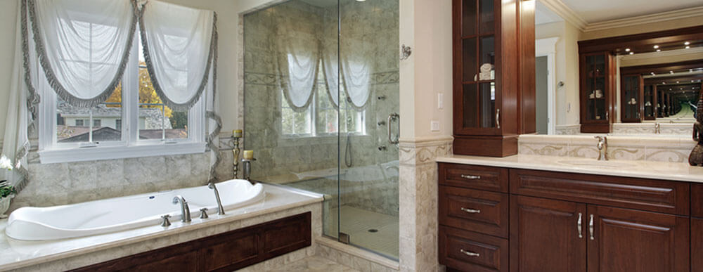 Ultimate master bathrooms like this one feature custom built vanities, large bathtub and jetted walk in shower with frameless glass doors.