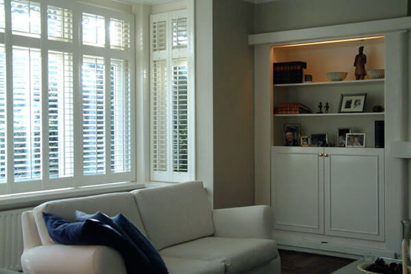 White wooden blinds and built in cabinetry.