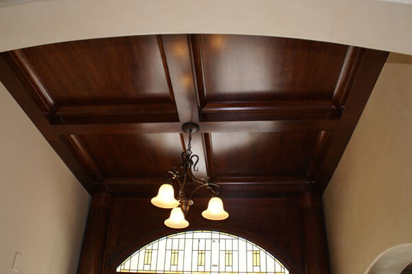 Wood coffered ceiling in entry of executive home in Wichita.