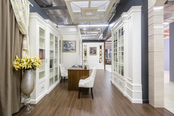 White enameled custom commercial cabinetry in elegant showroom