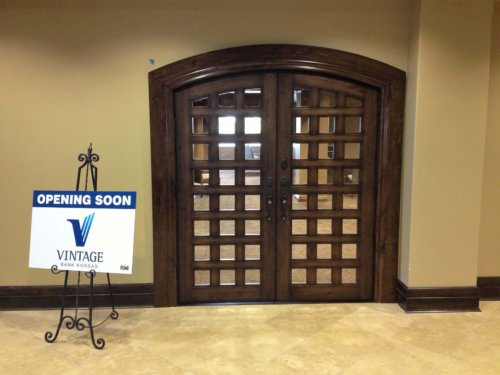 Knotty alder doors and large round top casing at entry to local Wichita, Ks. bank.