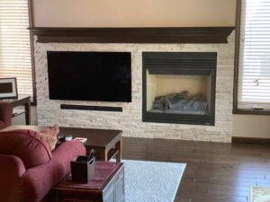 Dry stack marble fireplace and entertainment center with hidden components