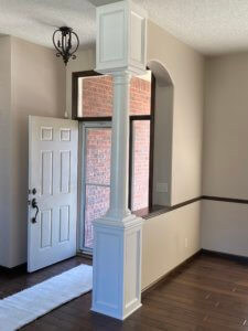 Column at home entry with paneled top and base finished in enamel paint